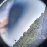 Pohled na obzor skrz dalekohled